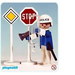 Policeman with 2 road signs