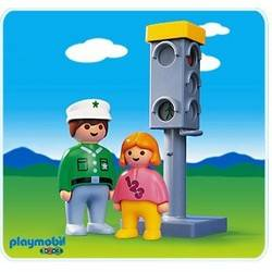 Policeman and kids at the traffic light